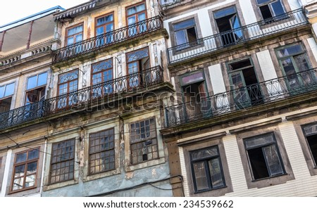 Typical portuguese ruined buildings in downtown Porto. - stock photo