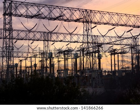 typical power lines, pylon and electrical substation. A high voltage complex. - stock photo