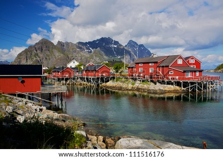 Typical red fishing huts called Rorbu on Lofoten islands in Norway