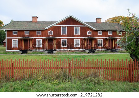 Typical red house environment in Sweden - stock photo