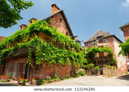 Typical red house in French Collogne la Rouge