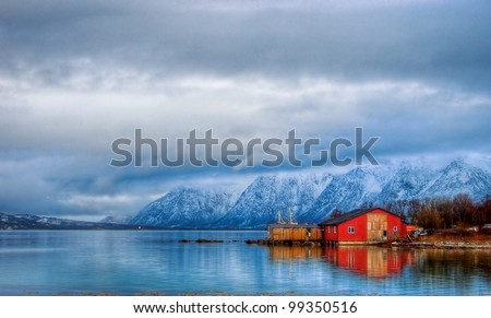 Typical red house on coast - stock photo