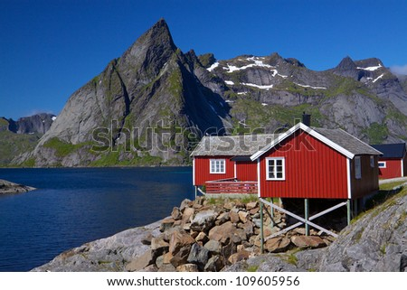 Typical red rorbu fishing hut by the fjord on Lofoten islands in Norway