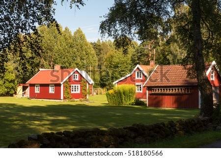 Typical red wooden farm buildings on the island of Oeland, Sweden.