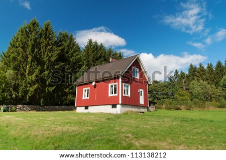 Typical red wooden house in Sweden - stock photo