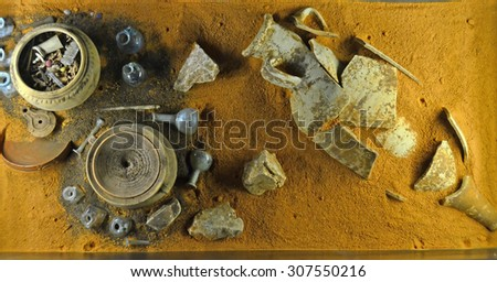 Typical roman burial goods including, pottery, oil lamps, jars, glasses, and urn for the remains of the deceased - stock photo