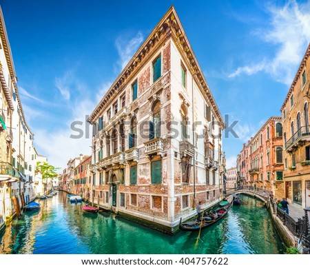 Typical romantic scene with traditional gondolas on channels between historic venetian buildings in Venice, Italy - stock photo