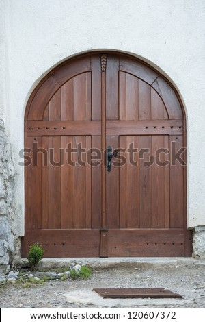 Typical round door made of wood in slovenia, europe