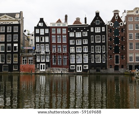 Typical row of Canal Houses in Amsterdam, The Netherlands - stock photo