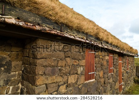Typical rural building with natural grass roof and silver birch rafters in Torshavn, Faroe Islands - stock photo