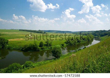Typical Russian landscape with river and a clear blue sky. - stock photo