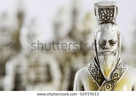 Typical samurai piece of marble, with an army in the background. - stock photo