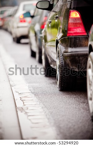 Typical scene during rush hour. A traffic jam with rows of cars. Shallow depth of field. - stock photo