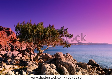 Typical Seascape Greek Island of Rhodes With The Rugged Coast. Sunset - stock photo