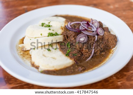 Typical serving of Beef Goulash and Bread Dumplings - stock photo