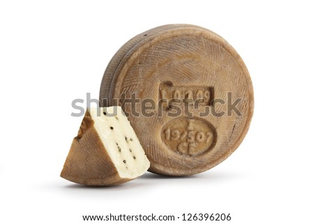 Typical Sicilian cheese from sheep, with black pepper. On white background - stock photo