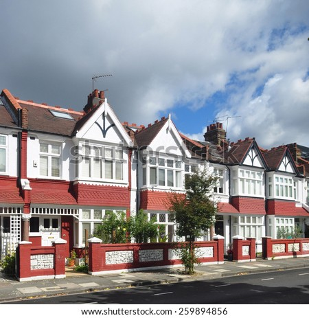 Typical small Edwardian period terraced houses built in 1913, unusually without parked cars in London, UK. - stock photo