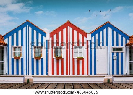 Typical small wooden houses with colorful stripes in Costa Nova neighborhood, Aveiro, Portugal.