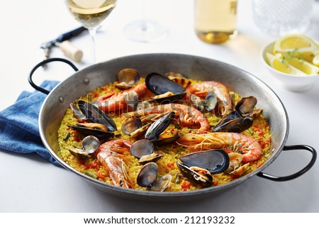 Typical spanish seafood paella in traditional pan