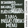 Typical spanish table of Tapas, Paellas, fideuas, Menu - stock photo
