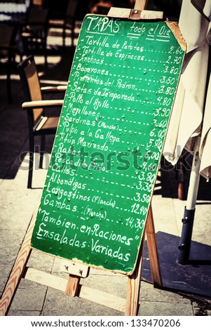Typical spanish tapas chalkboard. - stock photo