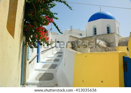 Typical steeple of greece in the small and colorful island of Santorini - stock photo