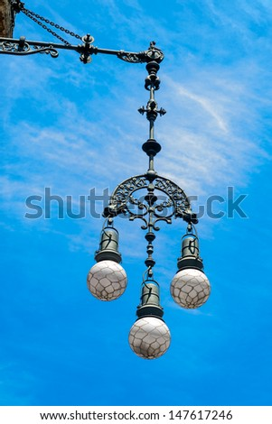 Typical street lamp in Barcelona - stock photo