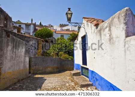 Typical street of Obidos, a medieval fortified town in Portugal