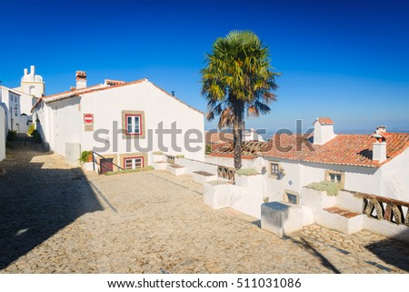 Typical street with traditional white houses in medieval village Marvao. Alentejo. Portugal
