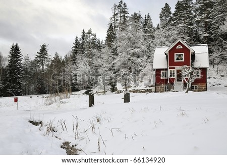 Typical Swedish house in winter landscape - stock photo