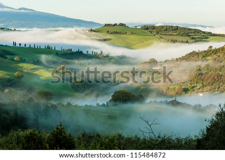 Typical Tuscan landscape in morning mist - stock photo