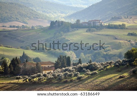 Typical Tuscan landscape in the evening sun - stock photo