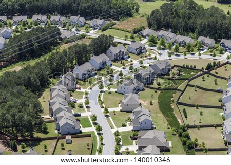 Typical upscale modern suburb aerial in the eastern United States. - stock photo