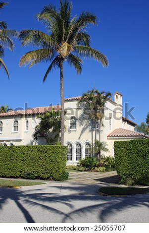 Typical upscale residence on a palm tree-lined street in Palm Beach, Florida