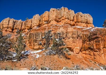 Typical Utah blue sky day to highlight the orange rock formations along Scenic Byway 12. - stock photo