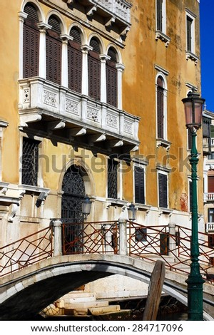 Typical venetian building, its windows and bridge. Venice, Italy  - stock photo