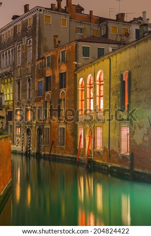 Typical Venetian house on the side of the Grand Canal at night in Venice, Italy  - stock photo