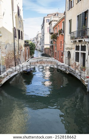 Typical venetian residential canal with reflection on water, Cannaregio, Venice Italy - stock photo