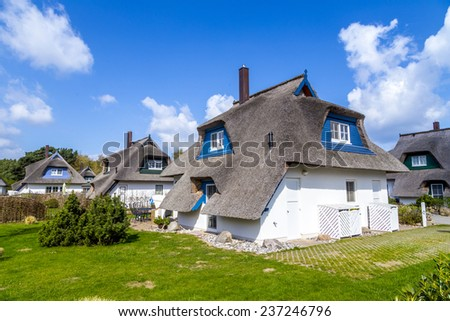 typical village house with reed roof in Usedom - stock photo