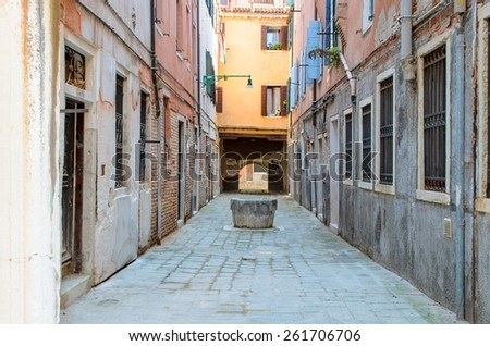 Typical well in calle alley, Venice, Italy