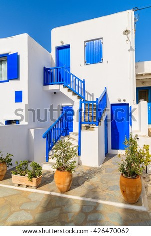 Typical white Greek house with blue doors and windows on island of Mykonos, Greece - stock photo