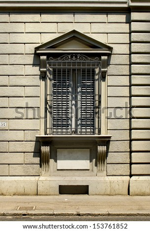 Typical window from Florentine architecture in monumental building. Florence, Italy - stock photo