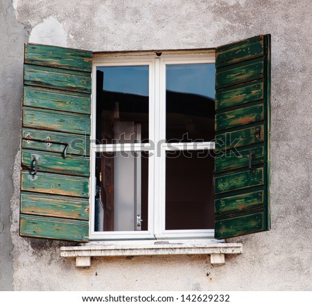 Typical window in a historical house in Caorle, Italy