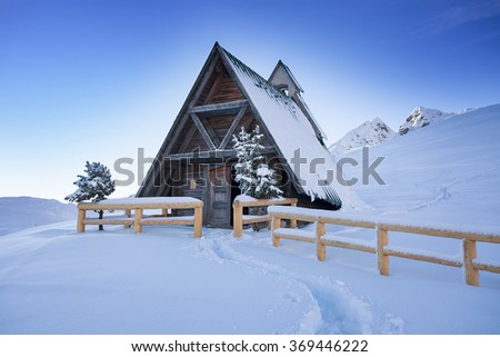 Typical wooden chalet in the Dolomites mountain in winter, South Tyrol, Passo Giau, Dolomites, Italy - stock photo