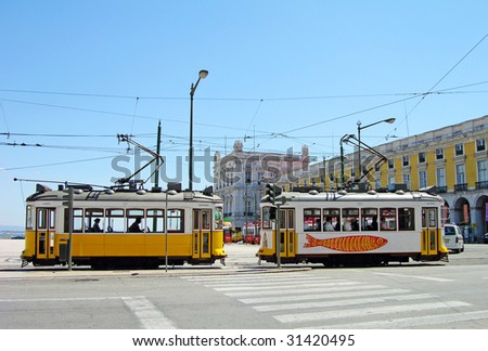 Typical yellow trams in Lisbon downtown - stock photo