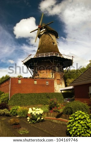 Typically East Frisian windmill in Upgant-Schott - stock photo