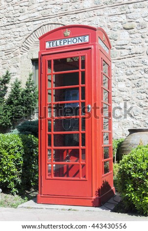 Typically english red phone booth in London - stock photo