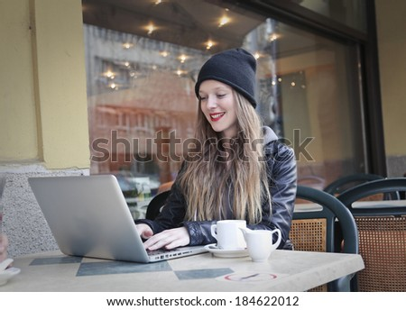 typing at the pub - stock photo