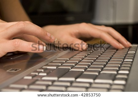 Typing on a Computer - stock photo