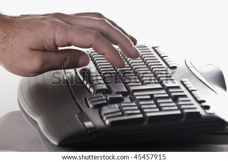 typing on the key board - stock photo
